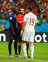 Referee Nicola Rizzoli steps in after an altercation between Bruno Martins of Netherlands and Diego Costa of Spain, TV cameras appear to suggest Costa headbutted Martins
