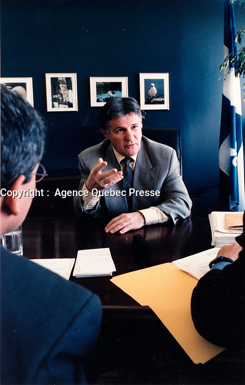 Le Ministre de l'environnement Paul Begin en entrevue a son bureau de Quebec, 1999 <br /> <br /> PHOTO : Agence Quebec Presse - stringer