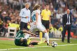 Real Madrid's Luka Modric and Real Betis's Cristian Tello during La Liga match between Real Madrid and Real Betis at Santiago Bernabeu Stadium in Madrid, Spain September 20, 2017. (ALTERPHOTOS/Borja B.Hojas)