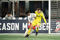 FOXBOROUGH, MA - OCTOBER 16: Ronaldo Damus #11 of North Texas SC collides with Keegan Meyer #50 of New England Revolution II near the New England goal during a game between North Texas SC and New England Revolution II at Gillette Stadium on October 16, 2020 in Foxborough, Massachusetts.