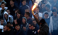 FC Partizan fan with flair, during the Serbian League soccer match in Belgrade, Serbia, Saturday, October  24, 2010. (Srdjan Stevanovic/Starsportphoto.com)