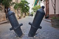Cuba, Havana.  Old Cannons Closing Street to Vehicular Traffic, Old Havana.