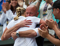 July 5, 2014, United Kingdom, London, Tennis, Wimbledon, AELTC, Ladie's Singles Final:  Eugenie Bouchard (CAN)  vs Petra Kvitova (CZE), Pictured: Petra Kvitova shows her emotion when she falls into the arms of her coach David Kotyza<br /> Photo: Tennisimages/Henk Koster