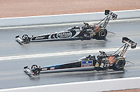 Apr. 7, 2013; Las Vegas, NV, USA: NHRA top fuel dragster driver David Grubnic (near lane) alongside Shawn Langdon during the Summitracing.com Nationals at the Strip at Las Vegas Motor Speedway. Mandatory Credit: Mark J. Rebilas-