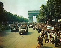 Paris , FRANCE  - August 25, 1944 -<br /> Crowds of French patriots line the Champs Elysees to view Allied tanks and half tracks pass through the Arc du Triomphe, after Paris was liberated on August 25, 1944