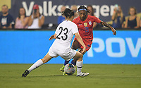 CHARLOTTE, NC - OCTOBER 03: Crystal Dunn #19 of the United States attempts to move past MOON Mira #11 of Korea Republic during a game between USA and Korea Republic at Bank of American Stadium, on October 03, 2019 in Charlotte, NC.