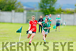 Rathmore's Aoife O'Callaghan slip past Kate Anne O'Connor of Na Gaeil in the Randles Bros Kerry LGFA Senior Football Championship.