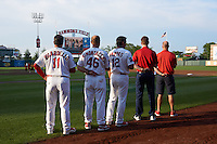 Springfield Cardinals staff including Dann Bilardello, Jason Simontacchi, and Erik Pappas during the national anthem before a game against the Frisco RoughRiders  on June 4, 2015 at Hammons Field in Springfield, Missouri.  Frisco defeated Springfield 8-7.  (Mike Janes/Four Seam Images)