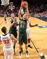 Nov. 12, 2010; Charlottesville, VA, USA;  William & Mary Tribe forward Tim Rusthoven (22) grabs a rebound in front of Virginia Cavaliers guard Thomas Rogers (32) during the game at the John Paul Jones Arena. Virginia won 76-52.  Mandatory Credit: Andrew Shurtleff