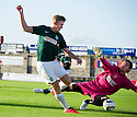 East Fife's Allan Fleming saves from  Hibs' Lewis Allan.