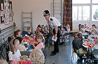 Police officer the youth affairs officer talking to the children whilst they eat their lunch. This image may only be used to portray the subject in a positive manner..©shoutpictures.com..john@shoutpictures.com