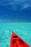 A red kayak cruising Inside the lagoon of Yap Micronesia