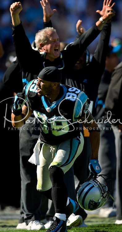 Carolina Panthers wide receiver Steve Smith (89) celebrates along with head coach John Fox against the Arizona Cardinals during an NFL football game at Bank of America Stadium in Charlotte, NC.