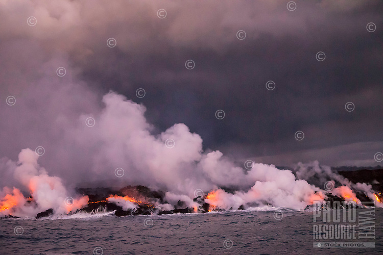 August 2018: Lava from Kilauea Volcano's Fissure 8 flows into to the ocean off the Puna coastline of the Big Island of Hawai'i. This image was taken a week before the 35-year-old eruption ended.