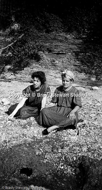 North East PA: Helen Stewart and Aunt Maggie relaxing on the rocks on the Lake Erie shoreline.  During the early 1900s, the Stewart family vacationed on Lake Erie near North East Pennsylvania. Since hotels and motels were non-existent, camping was the only viable option for a large number of vacationers