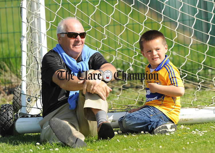 Liam Murphy of Newmarket with his grandnephew Jamie Gallagher, Offaly, during the Oscar Traynor Trophy Final against AUL Dublin at AUL Complex, Clonshaugh, Dublin. Photograph by John Kelly.
