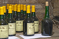 Bottles aging in the cellar. Marc de Bourgogne. Domaine Marc Jomain, Puligny Montrachet, Cote de Beaune, d'Or, Burgundy, France