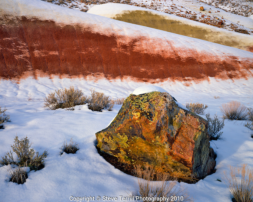 Snow melting away from slopes at the Painted Hills unit of  John Day Fossil Beds National Momument, Oregon