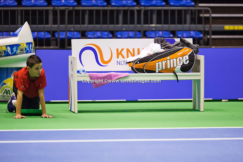 Rotterdam, Netherlands, December 17, 2015,  Topsport Centrum, Lotto NK Tennis, Bench with racket bag and ballboy<br /> Photo: Tennisimages/Henk Koster