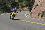 Male motorcyclist going uphill on Flagstaff Mountain Road west of Denver, Colorado, USA .  John leads private photo tours in Boulder and throughout Colorado. Year-round.