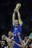 Italian captain (5) Fabio Cannavaro holds the World Cup high after the game.  Italy defeated France on penalty kicks after leaving the score tied, 1-1, in regulation time in the FIFA World Cup final match at Olympic Stadium in Berlin, Germany, July 9, 2006.