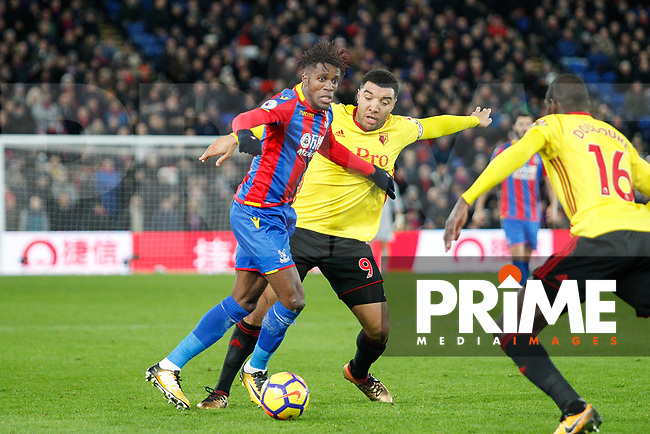 Wilfried Zaha of Crystal Palace holds off Troy Deeney of Watford during the Premier League match between Crystal Palace and Watford at Selhurst Park, London, England on 12 December 2017. Photo by Carlton Myrie / PRiME Media Images.
