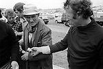 Money changing hands Gypsies at the Derby Day horse race Epsom Downs, Surrey 1974. 1970s UK