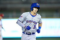 Jared Young (16) of the South Bend Cubs rounds the bases after hitting a home run against the Lansing Lugnuts at Cooley Law School Stadium on June 15, 2018 in Lansing, Michigan. The Lugnuts defeated the Cubs 6-4.  (Brian Westerholt/Four Seam Images)