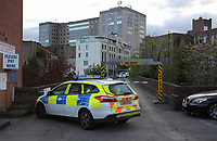 Pictured: A police car by the bridge that connects the train station to the car park. Friday 28 April 2017<br />