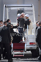 Pope Francis has given a lift to two lucky kids the two boys  are mounted on the Popemobile during his general audience in St. Peter's Square at the Vatican, Wednesday.April 16 2014.
