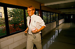 NHS 1980s Doctor Phil Hammond running with blood samples needed to be analysed, the machine in his special care unit has broken down. Royal United Hospital Bath Hospital Somerset 1989 UK