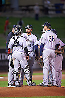 Kane County Cougars pitching coach Rich Sauveur (13) talks with starting pitcher Junior Garcia (18) and catcher Eduardo de Oleo (12) as Trevor Mitsui (36) and others listen in during the second game of a doubleheader against the Cedar Rapids Kernels on May 10, 2016 at Perfect Game Field in Cedar Rapids, Iowa.  Cedar Rapids defeated Kane County 3-2.  (Mike Janes/Four Seam Images)