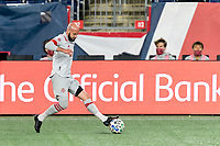 FOXBOROUGH, MA - OCTOBER 7: Laurent Ciman #26 of Toronto FC passes back to goalkeeper during a game between Toronto FC and New England Revolution at Gillette Stadium on October 7, 2020 in Foxborough, Massachusetts.
