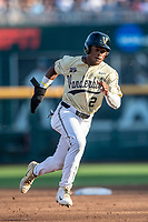 Vanderbilt Commodores second baseman Harrison Ray (2) runs to third base against the Louisville Cardinals in the NCAA College World Series on June 21, 2019 at TD Ameritrade Park in Omaha, Nebraska. Vanderbilt defeated Vanderbilt defeated Louisville 3-2 to head to the CWS Finals. (Andrew Woolley/Four Seam Images)