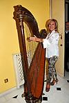 """ROSANNA LAMBERTUCCI<br /> """"PARTY ANTICRISI CON ESORCISMI"""" DI PAOLO PAZZAGLIA<br /> PALAZZO FERRAJOLI  ROMA 2011"""