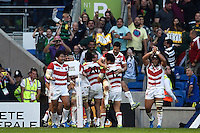 Japan players celebrate Karne Hesketh's match-winning try in the final play. Rugby World Cup Pool B match between South Africa and Japan on September 19, 2015 at the Brighton Community Stadium in Brighton, England. Photo by: Patrick Khachfe / Stewart Communications