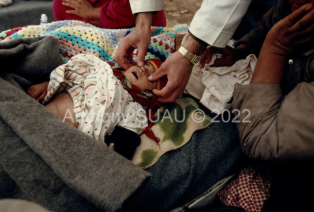 Isikveren, Turkey.April 14, 1991..A medic from Medecins Sans Frontiers - MSF (Doctors without Borders) pronounces a child dead in front of his mother in a makeshift  medical tent inside the Kurdish refugee camp. Many of children in the camp suffered from dehydration. The mountain top Kurdish refugee camp became home to an estimated 300,000 refugees when they fled Saddam Hussein's post Gulf war persecution...In the wake of the 1991 Persian Gulf War rebellions in Southern and Northern Iraq occurred. The uprising in the Kurdish areas of Northern broke out in March, sparked by demoralized Iraqi Army troops returning from it's defeat against United States lead coalition forces in southern Iraq and Kuwait. Although the uprsing presented a threat to Iraqi President Saddam Hussein?s regime, his Iraqi Republican Guard suppressed the rebellion with massive force, as the expected US intervention never materialized. ..The faltering rebellion fueled a terrified mass exodus. The U.N. High Commissioner for Refugees called it the largest in its 40?year history. During March and early April, nearly two million of Iraqis escaped from strife-torn cities to the mountains along the northern borders and into Turkey and Iran. Their exodus was sudden and chaotic, with thousands fleeing on foot, on donkeys, or crammed onto open-backed trucks and tractors. Thousands, many of them children, died or suffered injury along the way, primarily from adverse weather, unhygienic conditions and insufficient food and medical care. Some were killed by army helicopters, which deliberately strafed columns of fleeing civilians. Others were injured when they stepped on land mines planted by Iraqi troops near the Iran border during the war. Greenpeace has estimated that at one point in 1991, an estimated 2,000 Kurds were dying every day...
