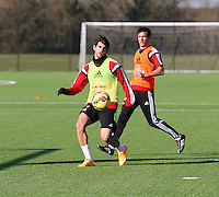 Pictured L-R: Nelson Oliveira and Kyle Naughton  Wednesday 04 February 2015<br /> Re: Swansea City FC training at Fairwood training ground, Swansea, south Wales, UK
