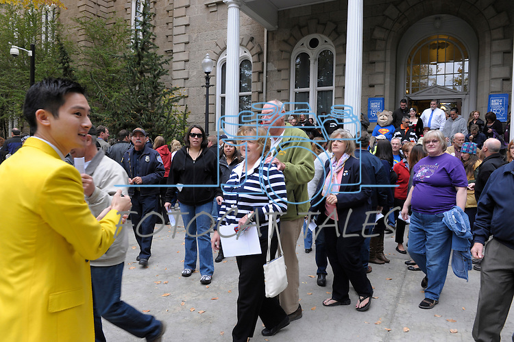 """Each person is counted Thursday, Oct. 30, 2014 after #NevadaSings!, a statewide sing-a-long of """"Home Means Nevada."""" Approximately 370 people took part  in the Carson City portion of the event, which seeks to establish a new record for the most people in an American state to sing their state song at the same time. Josh Fu, of Los Angeles, left, in yellow jacket, is one of serveral  with RecordSetters, counting people after the event."""