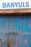 Banyuls in blue on white over a wine shop door. Collioure. Roussillon. The wine shop and tasting room. France. Europe.