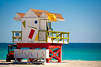 One of the iconic wooden lifeguard watch huts in South Beach, in front of the turquoise ocean, in Miami Beach Art Deco district, Florida USA