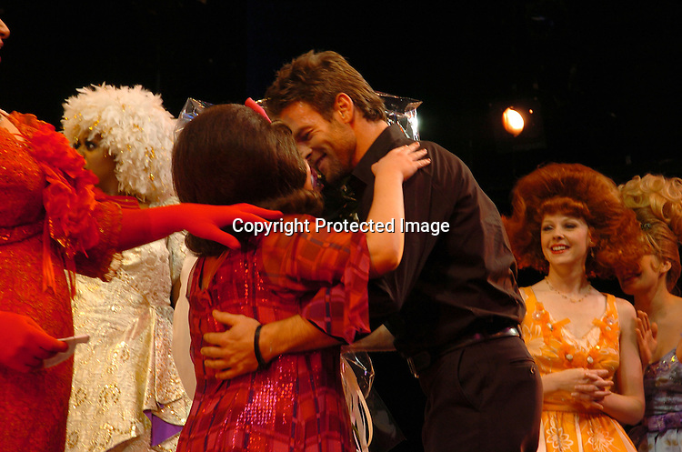 """Kathy Brier and Tim Adams giving her flowers during the curtain call ..at a performance of """"Hairspray"""" on December 18, 2003 at the Neil Simon Theatre and also at a party at Ruth's Chris..Steakhouse in New York City.  Nathaniel Marston and Timothy Adams gave Kathy flowers at the curtain call. Photo by Robin Platzer, Twin Images"""