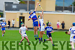 St Brendans Darragh Courtney and  Tralee Parnells Ruairi O'Sullivan take to the air to seek possession in the Intermediate Hurling Championship