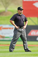 Umpire Jorge Teran handles the calls on the bases during the South Atlantic League game between the Delmarva Shorebirds and the Kannapolis Intimidators at CMC-Northeast Stadium on April 17, 2013 in Kannapolis, North Carolina.  The Shorebirds defeated the Intimidators 9-4.  (Brian Westerholt/Four Seam Images)