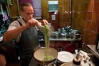 Chef Dominique le Stanc tosses fresh pasta 'au pistou' (pesto) before serving at his restaurant La Merenda, Nice, France, 16 October 2013.