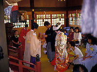 Shinto Buddist temple and preist at a traditional wedding ceremony
