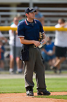Home plate umpire Tyler Wolpert during an Appalachian League game between the Pulaski Mariners and the Burlington Royals at Burlington Athletic Park August 6, 2009 in Burlington, North Carolina. (Photo by Brian Westerholt / Four Seam Images)