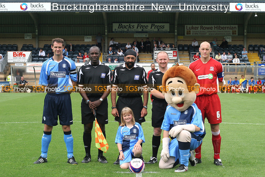 The two captains, David McCracken of Wycombe Wanderers and Adam Barrett of Southend United line up alongside match referee, Mr Jarnail Singh and his two assistant referees during Wycombe Wanderers vs Southend United, Friendly Match Football at Adams Park on 2nd August 2008