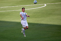 LOS ANGELES, CA - AUGUST 22: Daniel Steres #5 of Los Angeles Galaxy heads a ball during a game between Los Angeles Galaxy and Los Angeles FC at Banc of California Stadium on August 22, 2020 in Los Angeles, California.