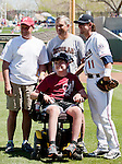 Joey Jacobsen, Nevada's 2012 Children's Miracle Network Hospitals Champion Child, threw out the first pitch before the  Reno Aces vs Sacramento River-Cats game played on Sunday afternoon, April 22, 2012 in Reno, Nevada.  Shown with, left to right, his father Tim Jacobsen, former coach Rob Rudnick, Aces catcher Mark Reed.
